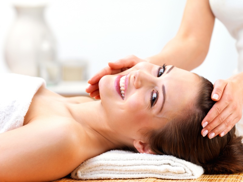 Happy smiling female getting massage