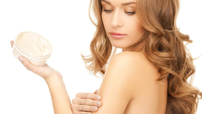 bigstock-beautiful-woman-applying-cream-461573621